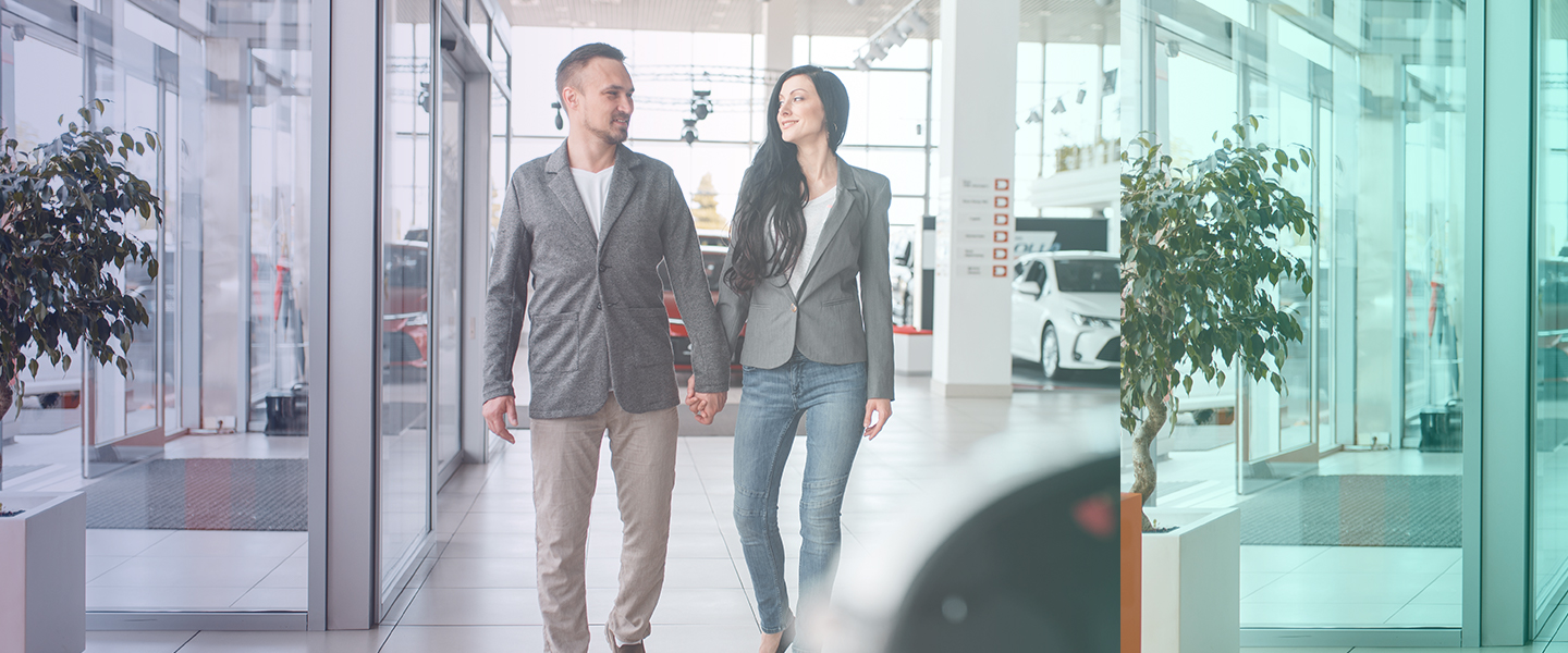 Car buyers having a good customer experience browsing a car showroom
